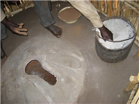 Eco pit latrine with bucket of ash & soil