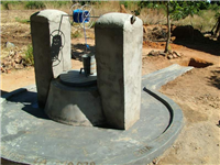Water-covered shallow well with windlass